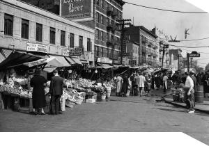 Italian pushcart market on Arthur and Crescent Avenues, Bronx, New York (1940)