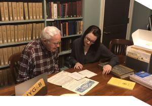 A professional genealogist consults with a client