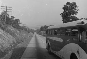 A bus travels on the highway