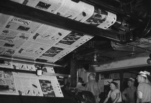 Newspapers come off the presses.