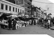 Italian pushcart market on Arthur and Crescent Avenues, Bronx, New York (1940)